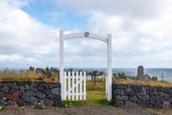 Gateway enterance to a rual cemetary by the sea