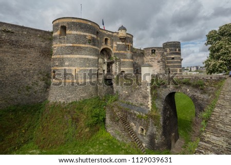 Gateway to Chateau d'Angers or the famous historic castle of Angers, once capital of Anjou, in Marne-et-Loire department of France #1129039631