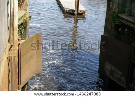 Gateways And River Water In Historical Oldenburg In The State of Lower Saxony of Germany. The city is situated by the Rivers Hunte and Haaren. #1436247083