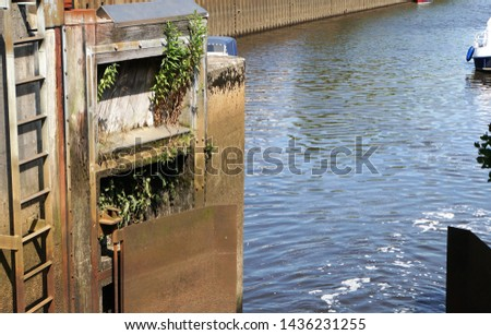 Gateways And River Water In Oldenburg In The State of Lower Saxony of Germany. The city is situated by the Rivers Hunte and Haaren. #1436231255