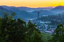 Gatlinburg Tennessee Sunrise. City skyline of the small resort town of Gatlinburg surrounded by the peaks of the Great Smoky Mountains National Park.