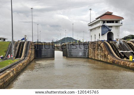 GATUN LOCKS - PANAMA CANAL-NOV. 7:This is the first set of locks situated on the Atlantic entrance of the Panama Canal. On nov. 7 2012 in Panama. Ships are raised a total of 87 feet above sea.