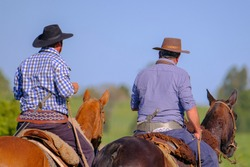 Gauchos on horses at a Criolla Festival in Caminos, Canelones, Uruguay, South America, also been seen in Argentina, Brazil and Chile