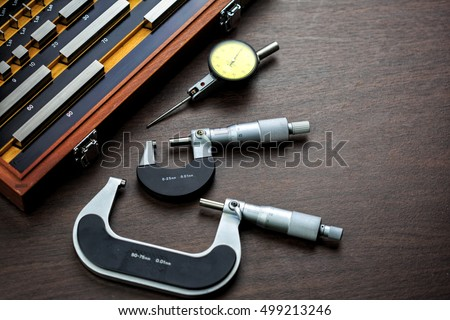 Gauge block set with outside micrometer and dial gauge is basic tool for use in manufacturing process industrial sector.