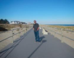 Gaussian blurred image of Guy in jeans posing on the Sea Girt boardwalk