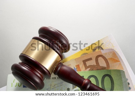 gavel and euro  on a gray gradient background