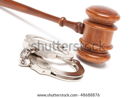 Gavel and Handcuffs Isolated on a White Background.