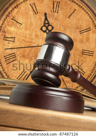 Gavel and old clock