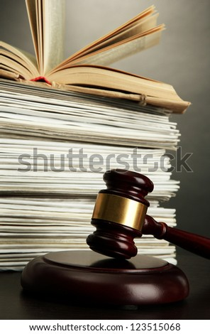 gavel and old papers on grey background