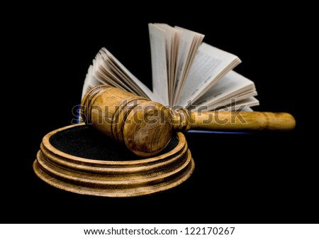 gavel and open book isolated on a black background closeup - stock photo