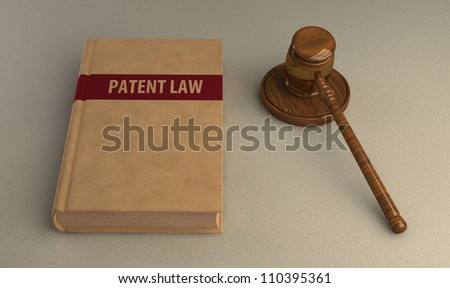 Gavel and patent law book on linen surface. Conceptual illustration