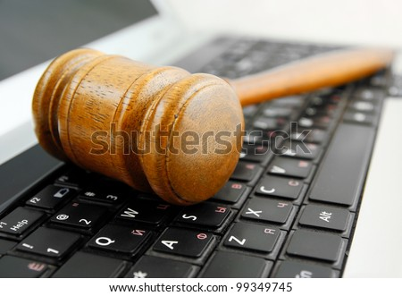 Gavel on a laptop computer close up