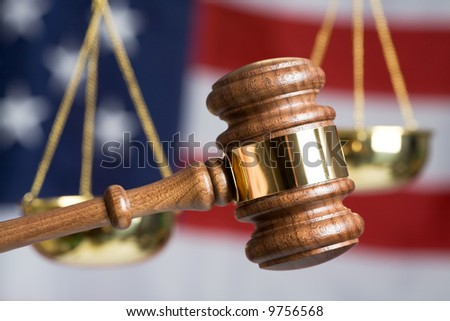 Gavel with American Flag and Justice of Scale in background
