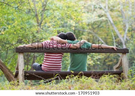 Gay couple enjoying autumn in the park