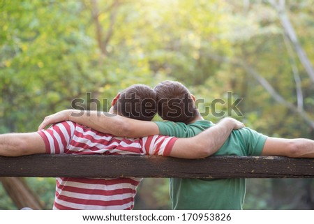 Gay couple enjoying autumn in the park