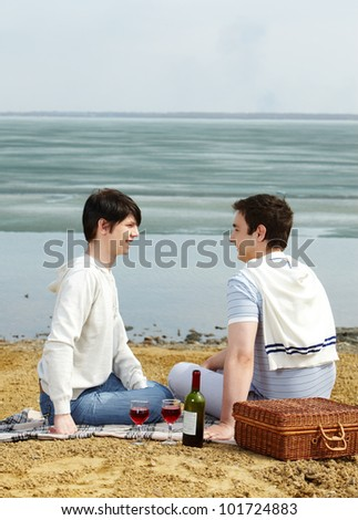Gay couple having a romantic picnic on a sunny spring day