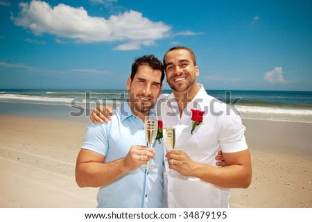 Gay couple on a beach after getting married