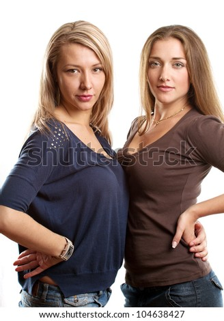 Gay couple, two women looking on camera against white background
