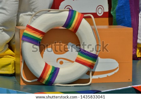Gay parade. Parade of pride. Lifebuoy decorated with rainbow flags. #1435833041