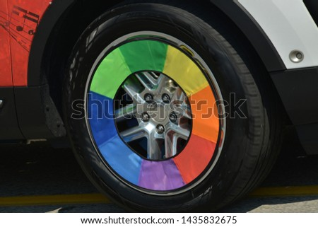 Gay parade. Parade of pride. rainbow decorations for car wheels. #1435832675