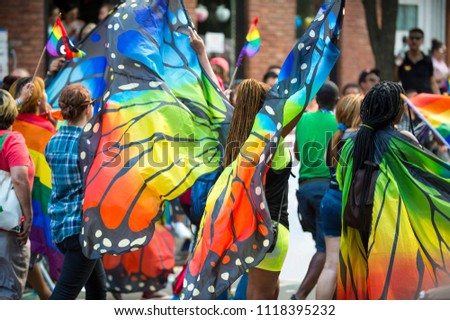 Gay pride carnival parade participants wearing colorful rainbow butterfly wing costumes in Greenwich Village Foto stock ©