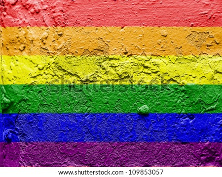 Gay pride flag painted on grunge wall