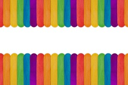 Gay rainbow LGBT flag design background. Symbol of the LGBT movement. LGBT Rights Concept. Homosexual flag texture. Wooden sticks are painted in the color of the rainbow. Copy space, banner, frame.