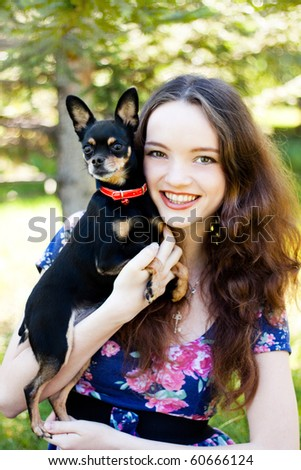 stock photo gay teen girl with a small dog in the hands 60666124 Old lady fucking teen girl with strap on dildo