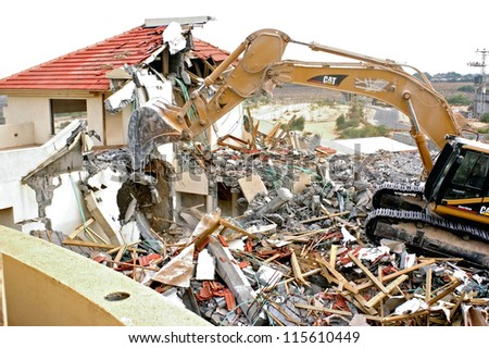 GAZA STRIP - AUGUST 31: A D-9 bulldozer is destroying an Israeli settlers home in the settlement Dugit in North Gaza Strip during Israel's unilateral disengagement plan on Aug 31 2006.