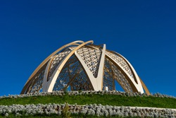 Gazebo in the park. Improvement of the Zhibek Zholy park. An architectural structure in the form of a gazebo. Artificial tree inside. Gazebo at the top of a decorative hill. Art Nouveau building
