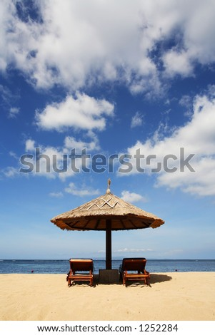 Gazebo on beautiful tropical beach. Shot against blue sky