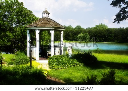 Gazebo situated by small town lake in a dreamy setting.