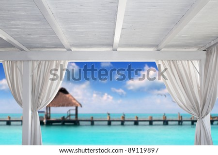 Gazebo white in tropical Caribbean beach with hut and pier  [photo-illustration]