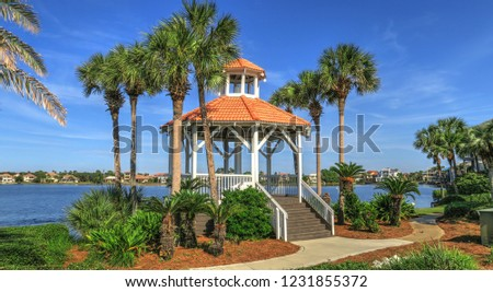 Gazebo With Red Tile Roof Over Water Pump on Destin Beach #1231855372