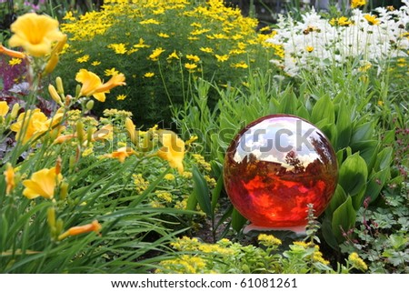 Gazing ball in beautifully landscaped yard.