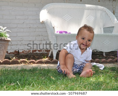 Gazing Smiling Happy Handsome Toddler Boy Sitting on Grass - stock photo