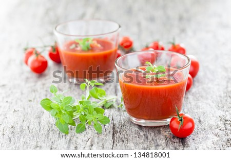 gazpacho in a glass with basil