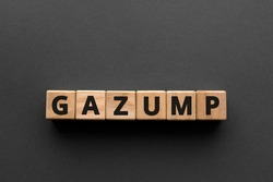 Gazump - words from wooden blocks with letters, rip off; ask an unreasonable price gazump concept, top view gray background