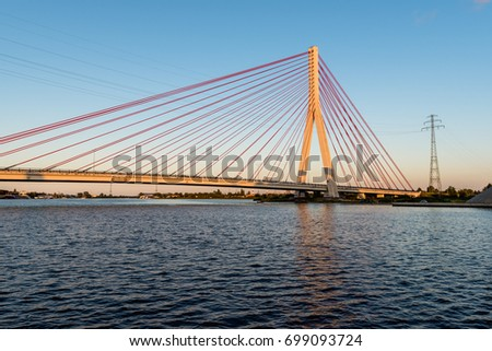 GDANSK, POLAND, AUGUST 14, 2017: Cable stayed bridge over Martwa Wisla river at dusk in Gdansk. Poland  Europe. #699093724