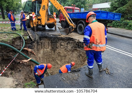 GDANSK, POLAND - JUNE 22: Workers repairing the damaged road after rupture pipe that caused the congested city. June 22, 2012 in Gdansk, Poland.