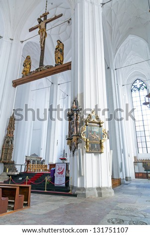 GDANSK, POLAND - 12 MARCH 2013: Interiors of St. Mary's Basilica in Gdansk on 12 March 2013. This Roman Catholic church built in 1379 is the largest brick church in the world.