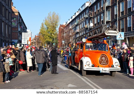 GDANSK, POLAND - NOVEMBER 11: The annual parade on the occasion of the Independence Day. March through the streets, and a demonstration of old vehicles, November 11, 2011 in Gdansk.