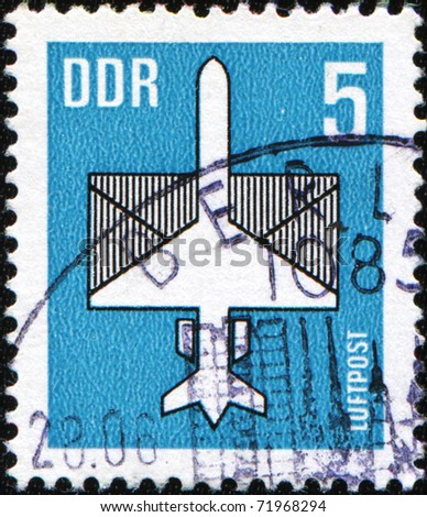 GDR - CIRCA 1982: A stamp printed in GDR (East Germany) shows airmail - the plane on the background of the envelope, circa 1982