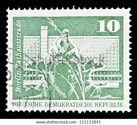 "GDR - CIRCA 1973: A stamp printed in GDR (East Germany) shows Neptune Fountain and City Hall Street, Berlin with the same inscription, from the series ""Landmarks in GDR"", circa 1973"