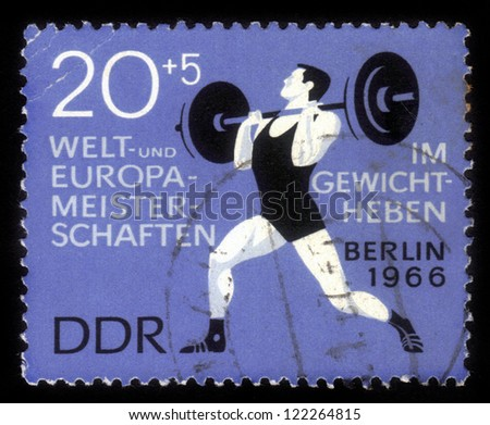 GDR - CIRCA 1966: A stamp printed in GDR (German Democratic Republic - East Germany) shows weightlifter, circa 1966