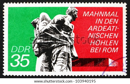 GDR - CIRCA 1974: a stamp printed in GDR shows Bound Guerrillas, Ardeatine Caves, Rome, Ardeatine massacre, circa 1974
