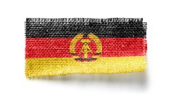 GDR flag on a piece of cloth on a white background