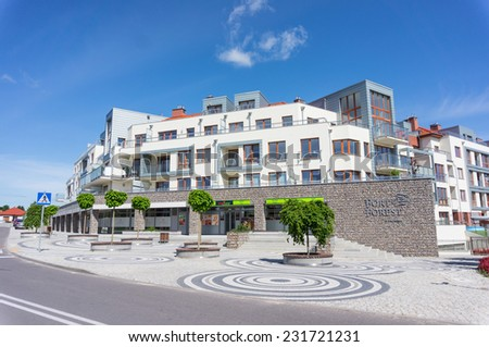 GDYNIA, POLAND - JUNE 16, 2014: Modern apartments building with small stores