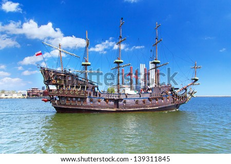 """GDYNIA, POLAND - MAY 19: """"Dragon"""" - pirate ship on the water of Baltic Sea in Gdynia on 19 May 2013. This ship imitating XVII century galleon is big tourist attraction of Tri city in Poland."""
