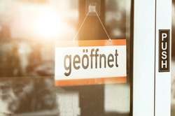 geöffnet, translated: open. sign at the entrance of a store and restaurant. german text